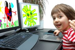 Photo a little girl draws at the computer. A girl 6 years old draws at the computer Royalty Free Stock Photo