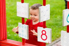 Little girl playing on the playground Stock Photos
