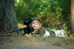 Photo of little girl with rifle Stock Photos