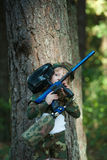 Photo of little girl with rifle Royalty Free Stock Image
