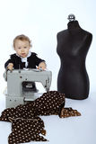 Photo of little girl with sewing machine Royalty Free Stock Photography