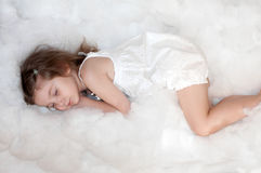 A photo of a little girl sleeping on a cotton wool cloud Stock Photography