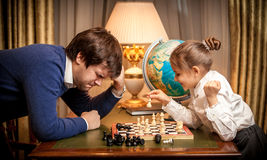 Photo of little girl won chess at man Royalty Free Stock Photo