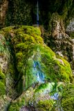 Photo of little waterfall flowing in cave Stock Photography