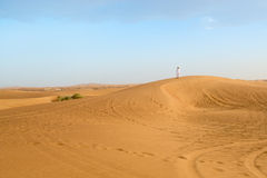 Photo of local resident standing on a dune of a desert in the Un Stock Photography