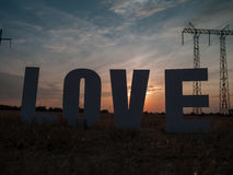 Photo love letters on sunset background Stock Images