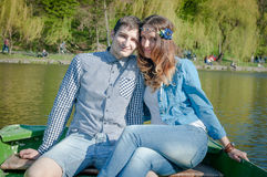 Photo loving couple on the lake. Boating on the lake loving couple Stock Photography