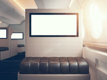 Photo of luxury airplane interior, first class. Blank digital panels holding. Horizontal mockup. 3d render Stock Photo