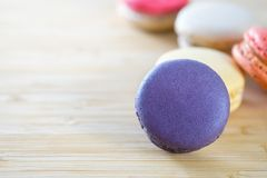 Photo of Macarons on Brown Wooden Surface Stock Image