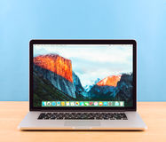 Photo of Macbook pro. Moscow, Russia - February 19, 2016:  Photo shoot of Macbook Pro on blue background.  MacBook is a brand of notebook computers manufactured Royalty Free Stock Photos