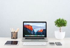 Photo of Macbook pro. Moscow, Russia - January 31, 2016: Photo of workplace with modern gadgets iPhone 6 ipad and Macbook Pro by Apple. Apple Inc. is an American Royalty Free Stock Photo