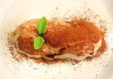 Photo of a macro of a delicious vanilla eclair. In a cafe stock image