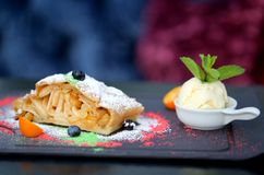 Photo of macro dessert charlotte. With raisins and an apple on a dark background stock images