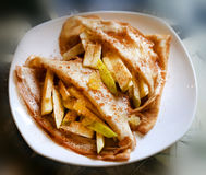 Photo of macro sweet pancakes. With cinnamon and apples in a cafe royalty free stock photos