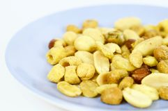 Roasted nuts ready to eat. Photo made with macro objective and in isolated background of nuts. Ideal photo to illustrate diets, healthy lifestyles, etc Royalty Free Stock Photo