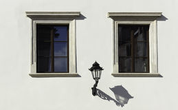 Wall of  building and lamp. Photo made in the old town of Krakow. Architectural details Royalty Free Stock Image