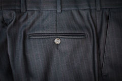 Photo of male classic trousers with back pocket. Closeup photo of male classic trousers with back pocket Stock Image