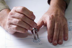 Male hands in the drawings Royalty Free Stock Photo