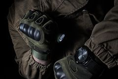 Tactical led flashlight and military watch stock photo