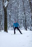Photo of male skier in woods in winter. Afternoon Royalty Free Stock Photography