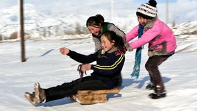 Children playing in snow ground  Stock Image
