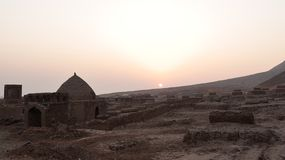 Sunset with ancient tomb Royalty Free Stock Photos
