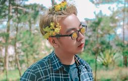 Photo of a Man with Flowers on His Hair stock photo