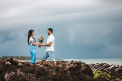 Photo of Man Giving Flowers to Woman Royalty Free Stock Photography
