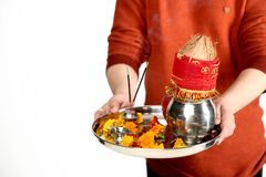 Photo of man hand is holding pooja thali for navratri festival royalty free stock photography