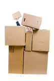 Photo of a man heap up with many boxes royalty free stock image