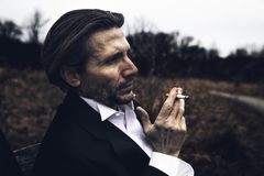 Photo of Man Holding a Cigarette Stock Photo