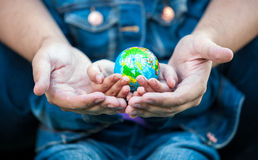 Photo of man holding girls hands with earth globe Royalty Free Stock Photos