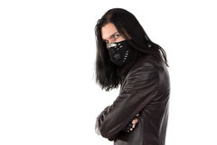 Photo of man in leather coat and mask Stock Image