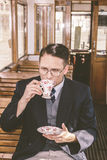 Photo of man with mustache and glasses on train wooden wagon dri Stock Photo