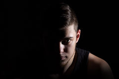 Photo of the man in shadow on black Royalty Free Stock Images