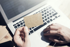 Photo Man Showing Blank Craft Business Card and Using Hand Modern Laptop Blurred Background. Mockup Ready for Private Royalty Free Stock Photography