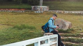 Photo of Man Sitting Near Rock stock photos