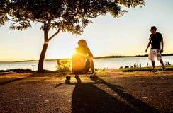 Photo of Man Sitting on Skateboard stock photo
