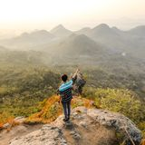 Photo of Man Standing on Rock Mountain Pointing Out Mountain stock images