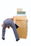 Photo of a man stooped over the boxes Stock Image