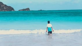 Photo of Man Walking by the Seashore royalty free stock image