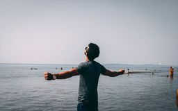 Photo of Man Wearing Gray Shirt Near Sea royalty free stock photography