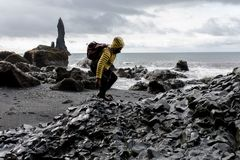 Photo of Man in Yellow Hoodie Near Seashore royalty free stock photography