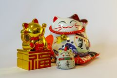 Maneki Neko - Japanese welcoming cat stock photos