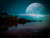 Photo Manipulation. Landscape of night sky with many stars. cine. Photo Manipulation. Landscape of night sky with many stars. Beautiful super moon behind partial stock image