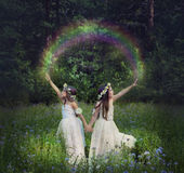 Photo manipulation with young girls who make a rainbow Royalty Free Stock Photography
