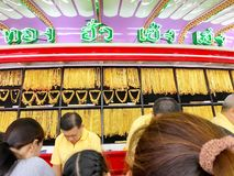 Many Thai people are queuing to buy Gold in HUA Seng Heng which. The photo of Many Thai people are queuing to buy Gold in HUA Seng Heng which is the first brand royalty free stock photography