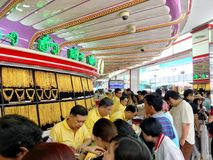Many Thai people are queuing to buy Gold in HUA Seng Heng which. The photo of Many Thai people are queuing to buy Gold in HUA Seng Heng which is the first brand stock images