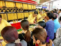 Many Thai people are queuing to buy Gold in HUA Seng Heng which. The photo of Many Thai people are queuing to buy Gold in HUA Seng Heng which is the first brand royalty free stock photos