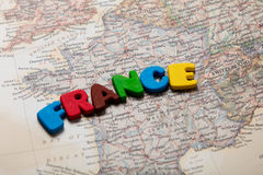 Photo of map of France and colorful letters on the wonderful bac Royalty Free Stock Photography
